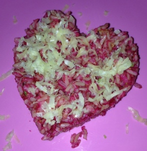 pink brown rice and zucchini heart with nut paste and sprinkle cheese