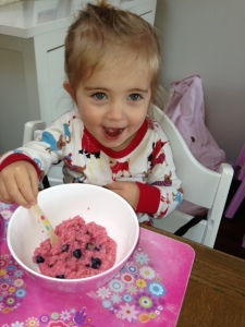 pink porridge with blueberries - and a spotty spoon