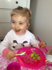 pink porridge with grapes - pink bowl green spoon