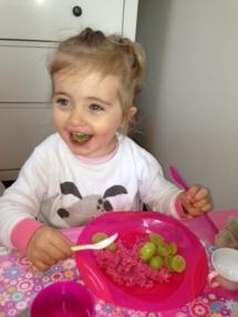 pink porridge with grapes - pink bowl green spoon