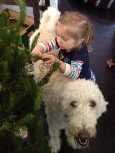 helping fuzzy cousin Barker decorate the tree