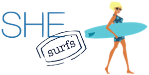 SHE surfs